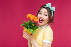 Amazed pretty pinup girl standing with mouth opened Royalty Free Stock Photo