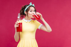 Amazed pretty pinup girl standing with mouth opened Stock Images