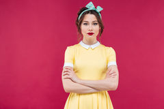 Amazed pretty pinup girl standing with mouth opened Stock Photography