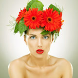 Amazed  with red gerbera flowers on her head Stock Images