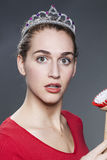 Amazed 20s beauty girl with dish brush in hand shocked Stock Images