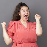 Amazed 20s big woman expressing joy and surprise Stock Photography