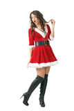 Amazed Santa girl with mouth open looking back over the shoulder. Full body length portrait isolated over white studio background Stock Image