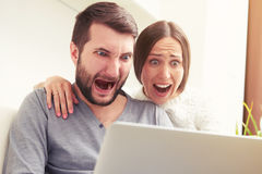 Amazed screaming couple Stock Photos