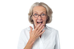 Amazed senior citizen. Old Woman with surprised expression on her face Royalty Free Stock Photo
