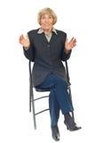 Amazed senior executive on chair stock image