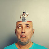 Amazed senior man and angry businesswoman Stock Images