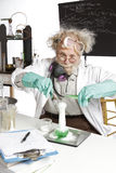 Amazed senior scientist with foaming beaker Royalty Free Stock Photography