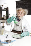 Amazed senior scientist with foaming beaker Royalty Free Stock Photos
