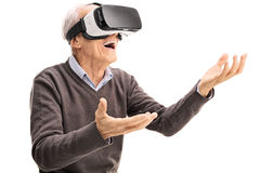 Amazed senior using a VR headset Royalty Free Stock Photography