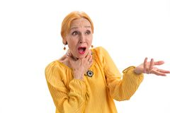 Amazed senior woman. Lady with opened mouth isolated. The unbelievable magic royalty free stock images