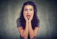 Amazed shocked woman looking at camera royalty free stock image