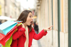 Amazed shopper watching stores Royalty Free Stock Photography