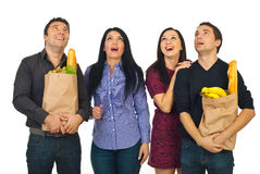 Amazed shoppers friends looking up Royalty Free Stock Images