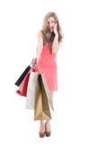 Amazed shopping girl. Amazed and surprised shopping girl on white background Stock Images