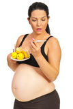 Amazed sick pregnant woman. Amazed sick pregnant  woman holding lemons,pills and thermometer isolated on white background Stock Photo
