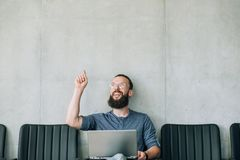 Amazed smiling man point up office business employ. Inspired amazed smiling man pointing index finger upward. office business employment concept. empty space for stock photos