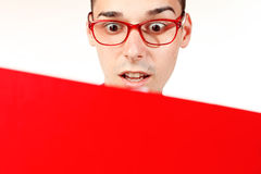 Amazed student with red notebook and red glasses Royalty Free Stock Images