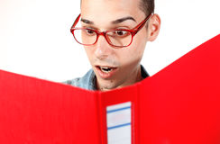 Amazed student with red notebook and red glasses Royalty Free Stock Photo