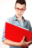 Amazed student with red notebook and red glasses Stock Image