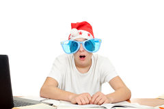 Amazed student in santa's hat Stock Photo
