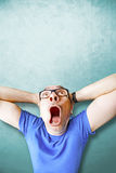 Amazed  and stunned man screaming. Amazed man stunned ligh blue background Stock Photos