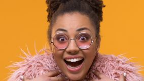 Amazed stylish female in pink eyeglasses looking camera, excitement expression. Stock footage stock video footage