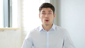 Amazed by Surprise , Wondering Man in Office, Indoor Stock Images
