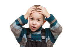 Amazed or surprised boy. Hand holding hairs on head Royalty Free Stock Images