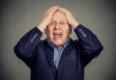 Amazed surprised elderly man. Isolated on gray background Royalty Free Stock Images