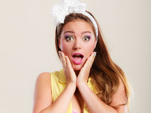 Amazed surprised pin up girl with mouth wide open. Stock Images