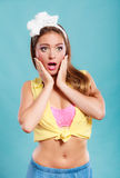 Amazed surprised pin up girl with mouth wide open. Royalty Free Stock Image