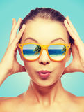 Amazed teenage girl in sunglasses. Travel, vacation, summer holidays and happy people concept - portrait of amazed teenage girl in sunglasses with beach Stock Images