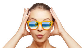 Amazed teenage girl in sunglasses Stock Photo