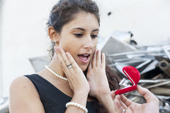Amazed teenager receives a ring as a gift Stock Photos