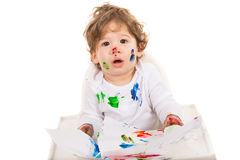 Amazed toddler boy. With colorful paints on face isolated on white background Royalty Free Stock Photography