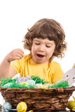 Amazed toddler choose Easter egg Stock Photography