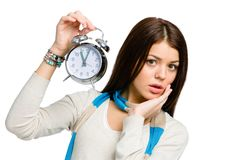 Amazed woman with alarm clock Royalty Free Stock Images