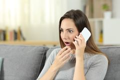 Amazed woman calling on phone royalty free stock photography