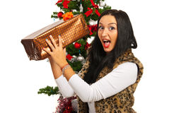 Amazed woman with Christmas present Royalty Free Stock Image