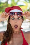 Amazed woman on christmas vacation at caribbean beach stock image