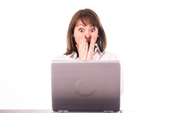 Amazed woman at the computer. Young amazed woman at the computer Royalty Free Stock Photos