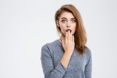 Amazed woman covering her mouth with palm Royalty Free Stock Images