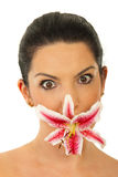 Amazed woman with flower mouth Royalty Free Stock Photo