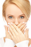Amazed woman with hand over mouth Royalty Free Stock Image