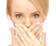 Amazed woman with hand over mouth. Picture of amazed woman with hand over mouth Royalty Free Stock Images