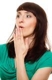 Amazed woman with hand over mouth Royalty Free Stock Photo