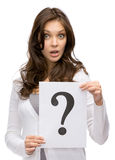 Amazed woman handing question mark Royalty Free Stock Photos