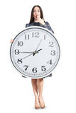 Amazed woman holding big clock Stock Images