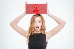 Amazed woman holding gift box Stock Image